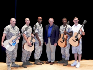 From left, Gunnery Sgt. James Cullen, Cpl. Noa Jent, Sgt. Maj. Leon Thornton, Marine Corps Community Services Deputy Director Chris Bennett, Lance Cpl. Carl Anderson and Cpl. Thomas Lucas pose with guitars signed and numbered by Richie Sambora. Photographer: Mike DiCicco