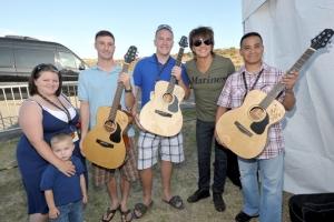 Richie Sambora with Voyage-Air Guitar recipients Brian Mullen, Wendell Tabios, David Vizcaino, Tacy Watson, Marcy Sanchez, Logan Watson