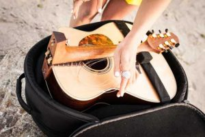 Travel guitar that folds in half
